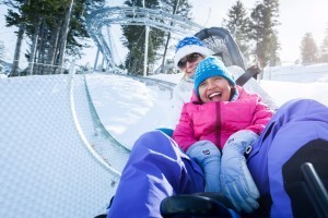 Snow King Mountain - Winter Cowboy Coaster :: Giddyup! The NEW Cowboy Coaster zips, twists and turns through nearly a mile of loops, curves and hairpin turns! Combo package - ride the Mountain Coaster & Tube Park for $30!