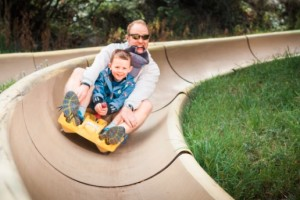 Snow King Mountain - Avalanche Alpine Slide :: Jackson's only Alpine Slide is an exciting ride down 350 feet over a half mile track at speeds up to 25 miles per hour! Incredible views of the Tetons & the town of Jackson.