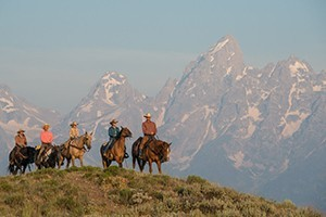 Triangle X - All inclusive guest ranch packages :: Authentic western dude ranch inside Teton Park. River trips, horseback & packtrips, kids riding program and nightly cookouts. 4 thru 7-day options available.