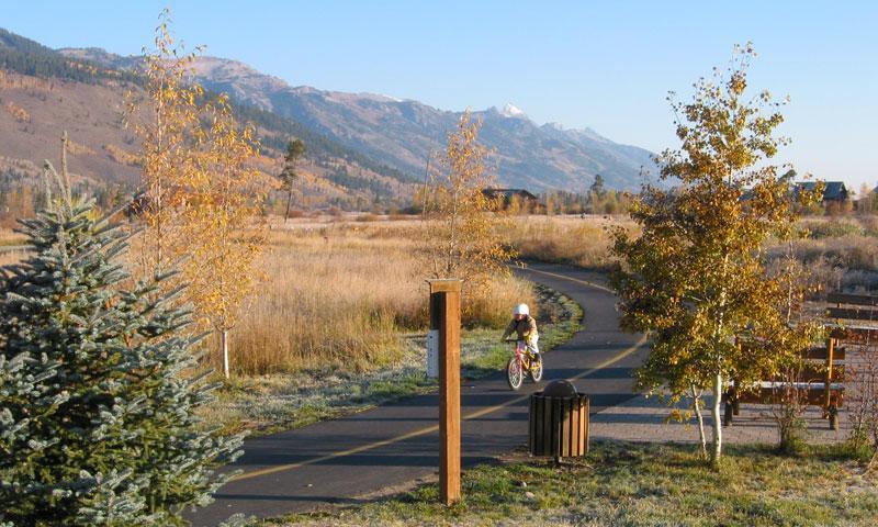 Kid riding bike along Jackson Paved Trail