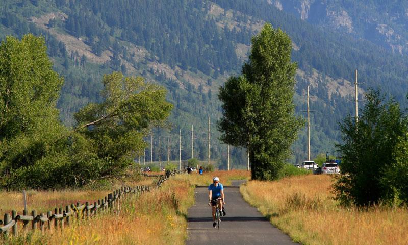 Biking along a Jackson Paved Trail