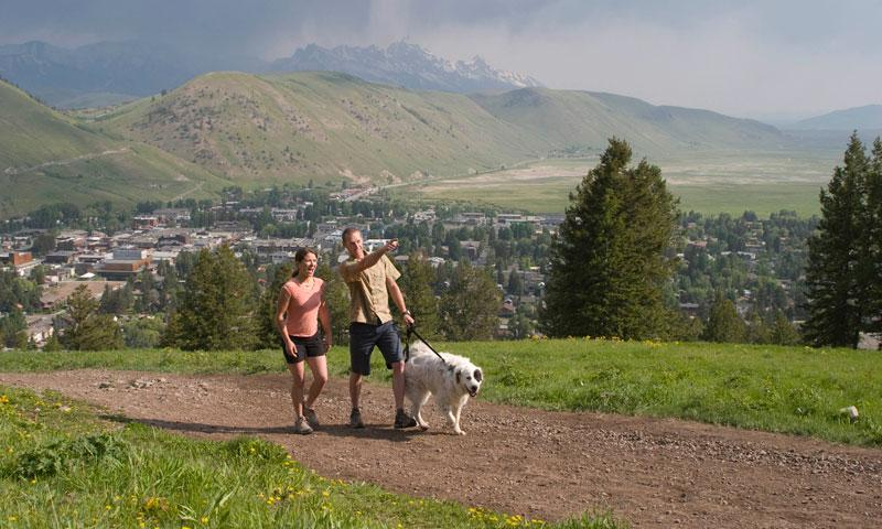 Couple hiking up Snow King with Dog